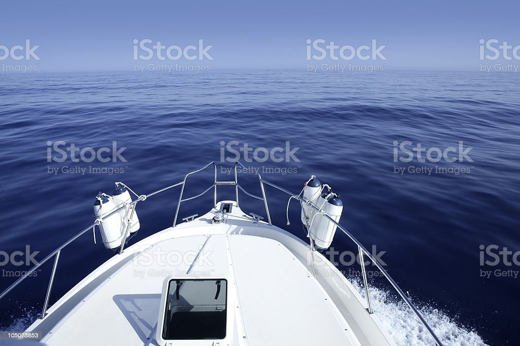 Boat on the blue Mediterranean Sea yachting stock photo