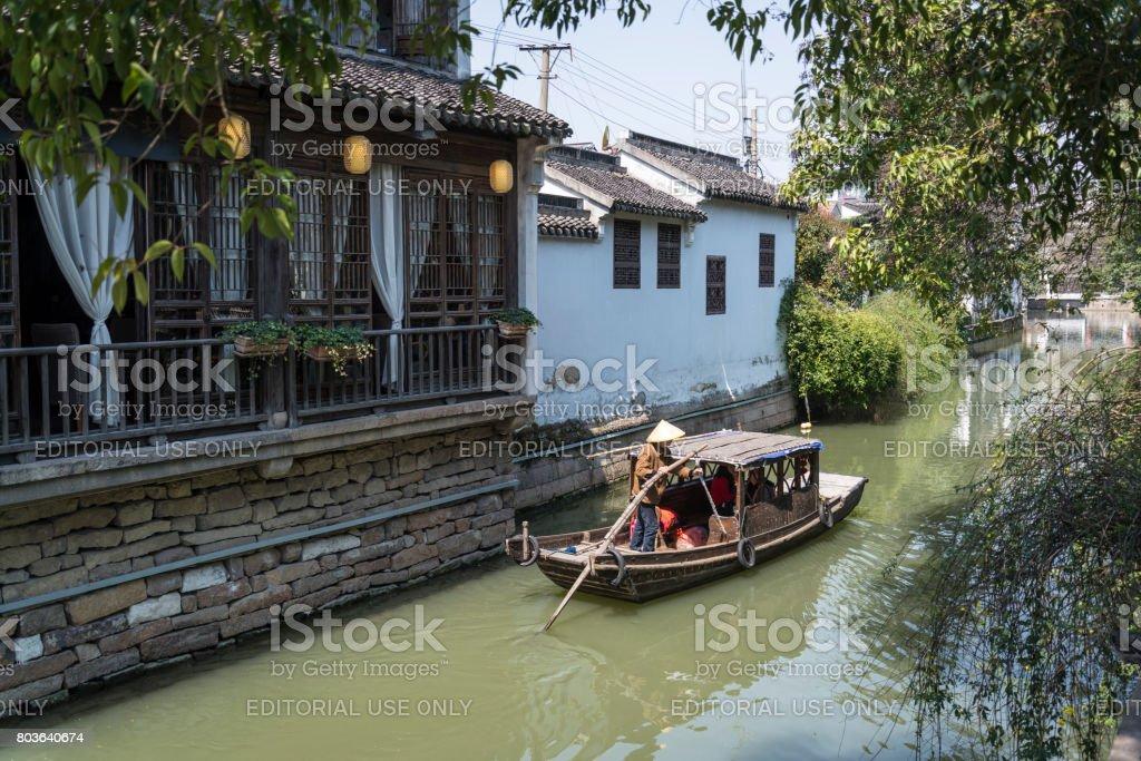 Boat on the canal in Pingjiang Road, ancient district, Suzhou, Jiangsu Province, China stock photo