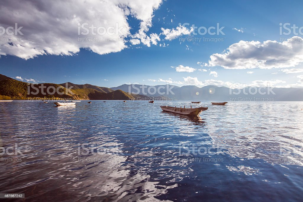 Boat on the Lugu lake stock photo