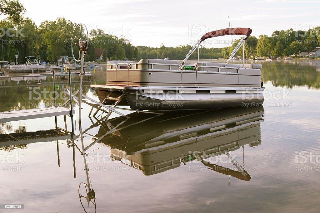 Boat on the Morning Lake stock photo