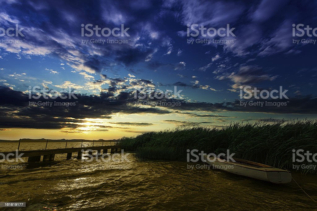 Boat on the reed royalty-free stock photo