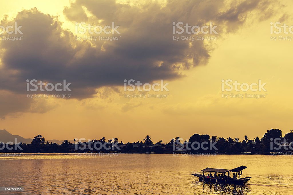 Boat on the River and Sunset in Borneo stock photo