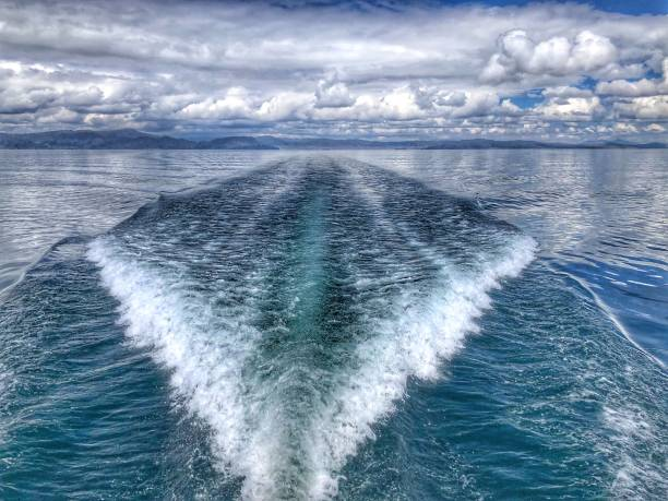 Boat on the sea to fast moving stock photo