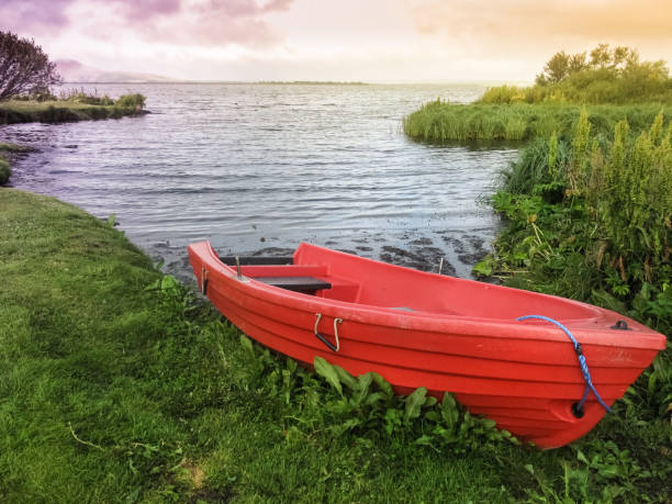 A boat on the shore of the lake Myvatn in Reykjahlíd, in north Iceland stock photo