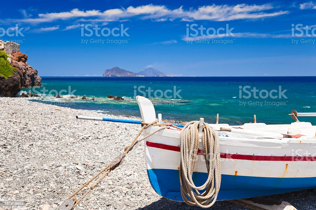 A boat on the shore of the Mediterranean stock photo