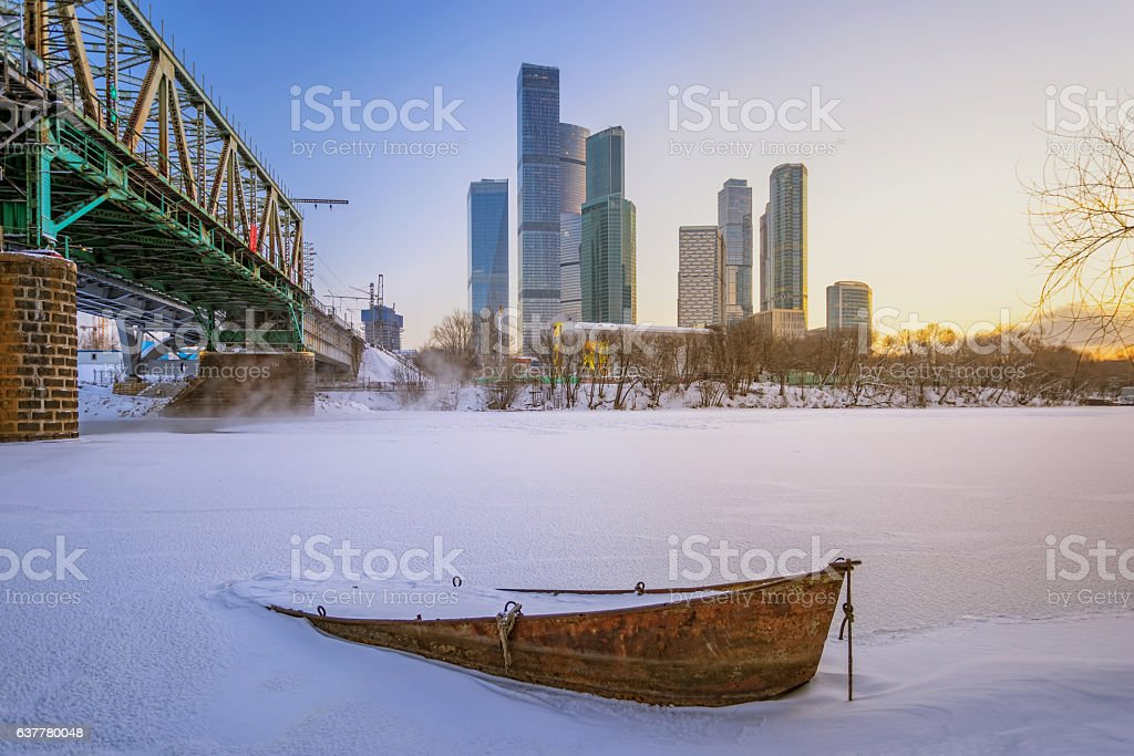 Boat on the winter against the of Moscow City stock photo