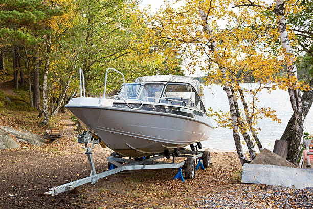 Boat on trailer coming out of water for the winter. stock photo