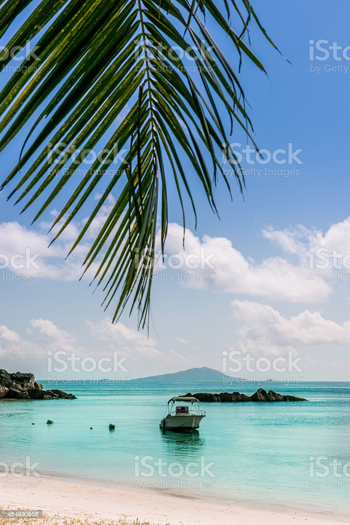 Boat on Tropical beach at Curieuse island Seychelles stock photo