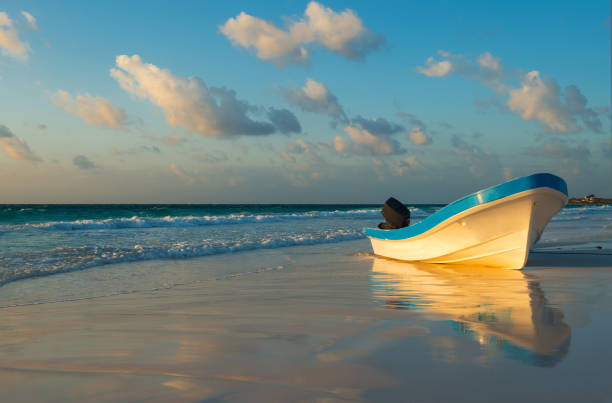 Boat on Tulum beach stock photo