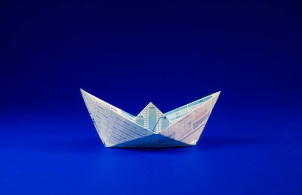 Boat paper graph on blue ocean .Business  concept stock photo