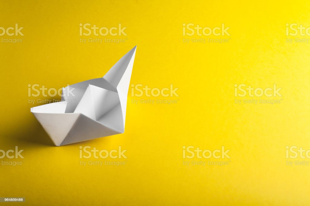 boat paper origami on the yellow background royalty-free stock photo