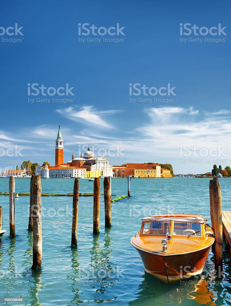 Boat parked beside the Riva degli Schiavoni in Venice, Italy - Photo