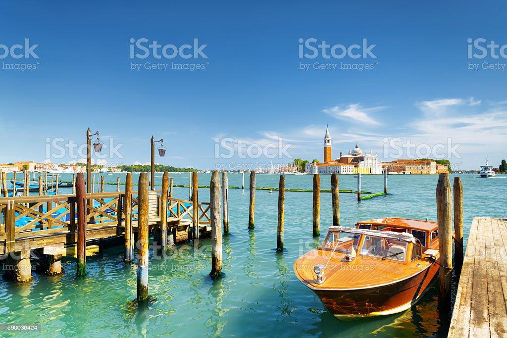 Boat parked beside the Riva degli Schiavoni, Venice, Italy - Photo