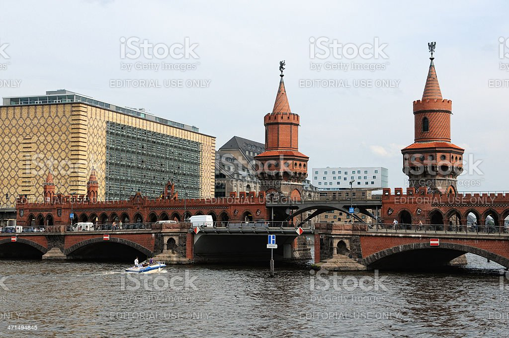 boat passing by Oberbaumbruecke in Berlin Kreuzberg stock photo