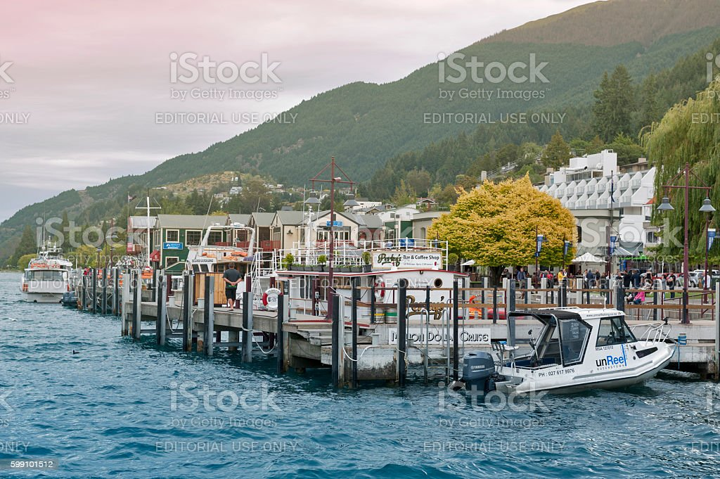 Boat piers at Queenstown lakefront by Lake Wakatipu, New Zealand stock photo