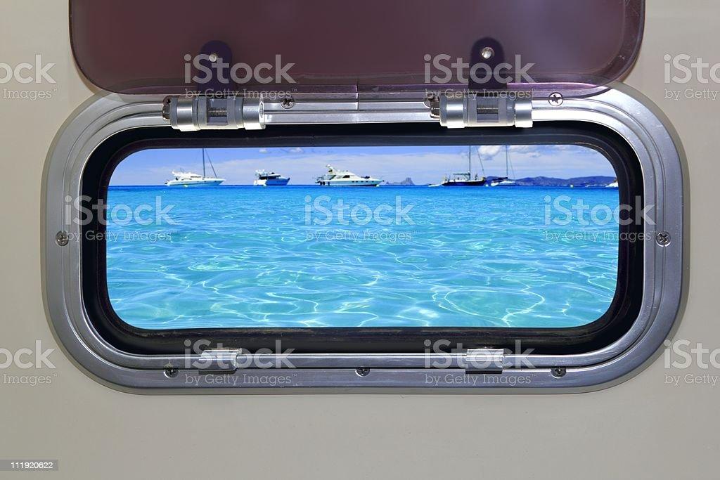 Boat porthole turquoise tropical blue ocean sea royalty-free stock photo