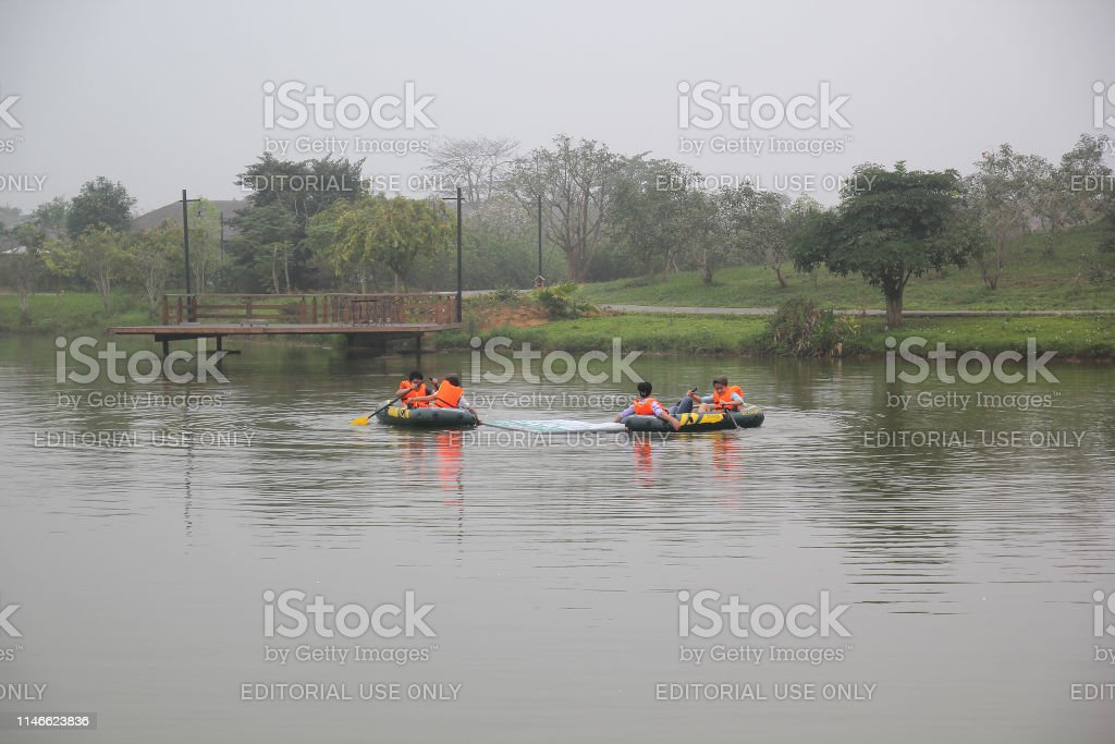 Two teams are joined in boat race because this is a team building...