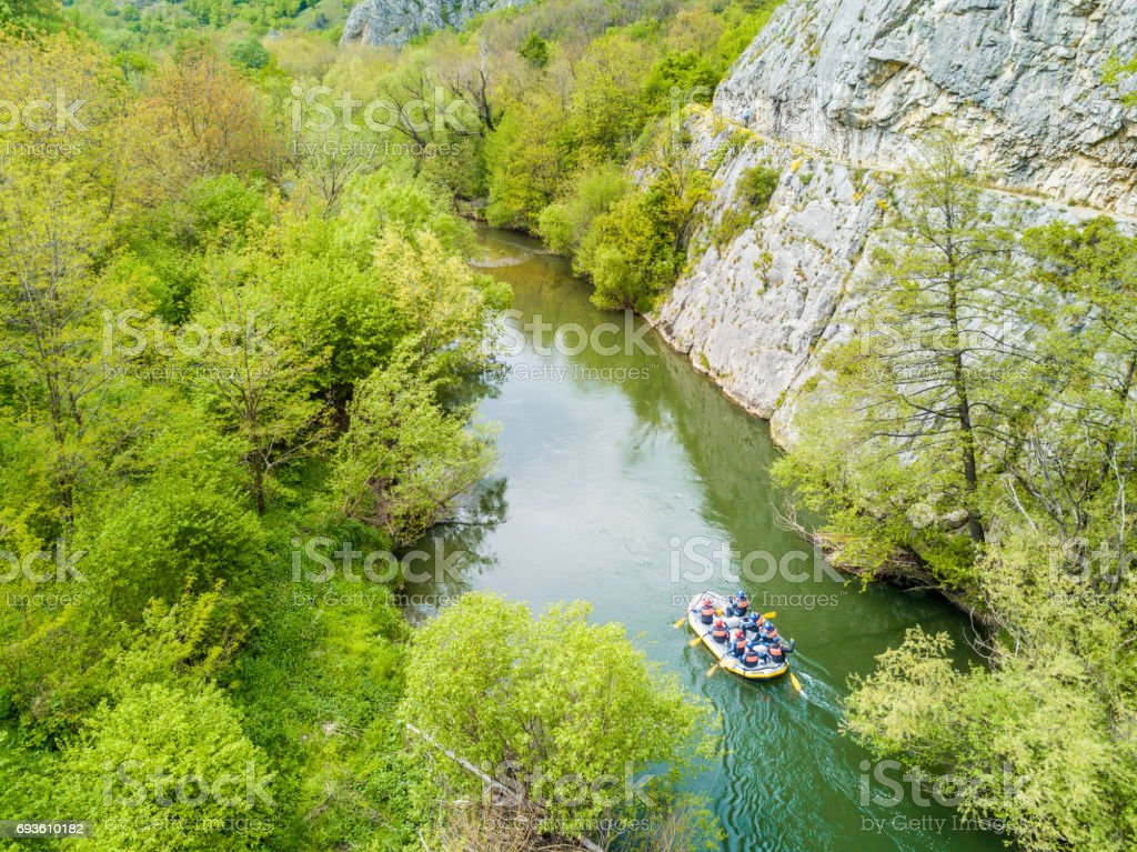 Boat rafting on river. Aerial view from a drone in Nera's Gorges, Romania (Cheile Nerei National Park) stock photo