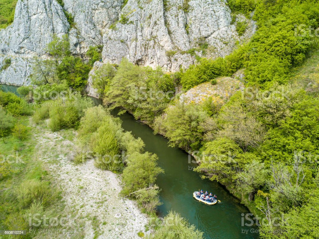 Boat rafting on river. Aerial view from a drone stock photo