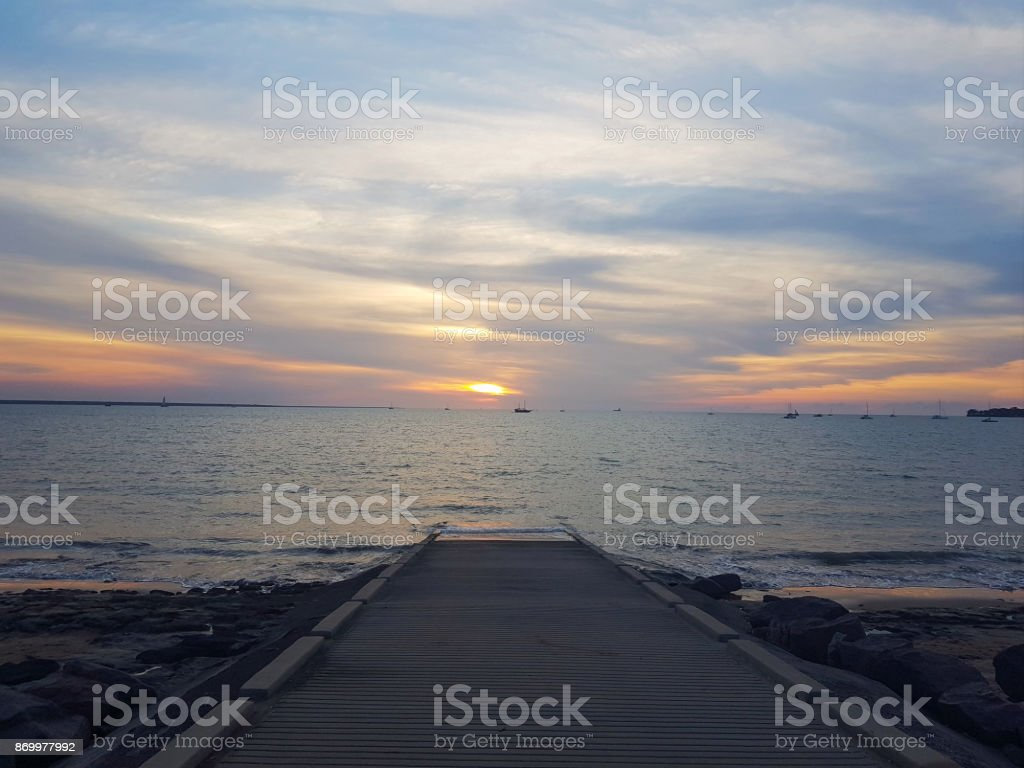 Boat ramp sunset stock photo