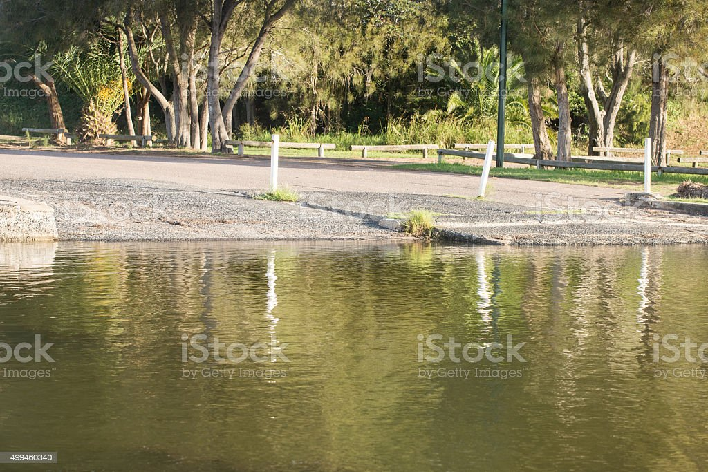 Boat Ramp with water reflection stock photo