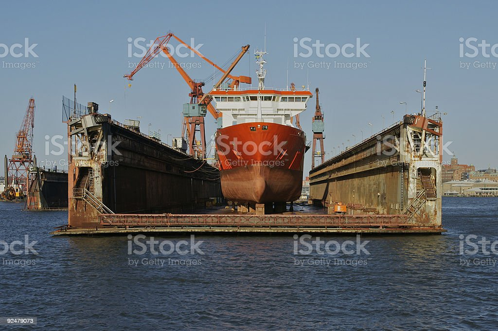 Boat receiving maintenance on dry dock stock photo