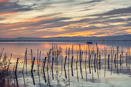 Boat ride in the Sunset of the calm waters of the Albufera de Valencia, Spain.