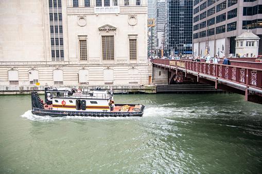 A boat rides past the famous, historic landmark Lyric Opera House