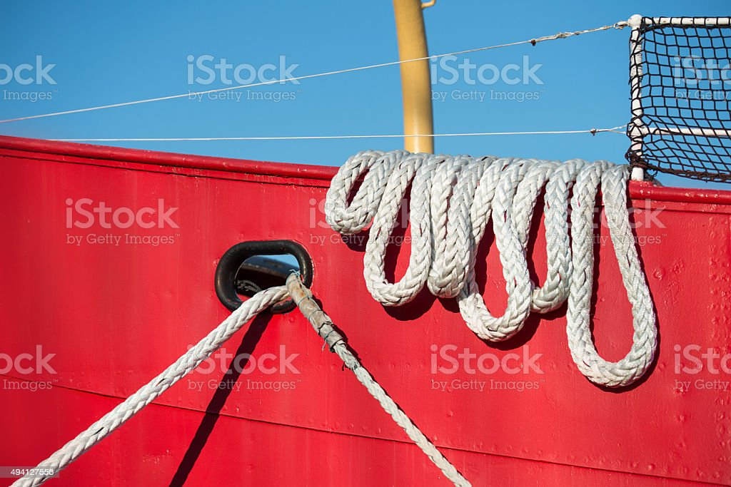 Boat rope at colorful moored fishing vessel stock photo