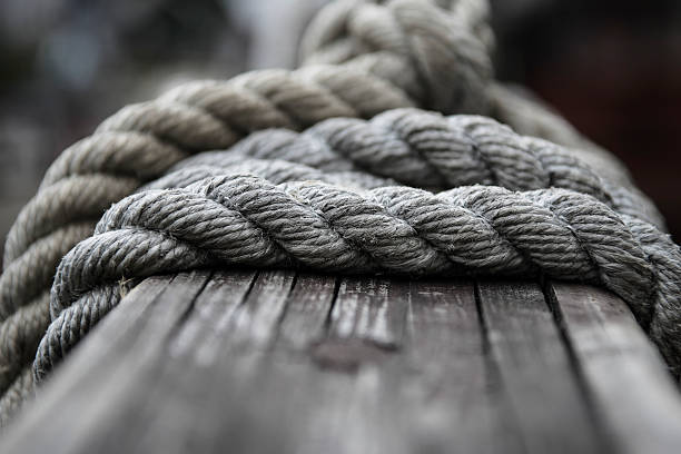 boat rope - knotted wood stock pictures, royalty-free photos & images