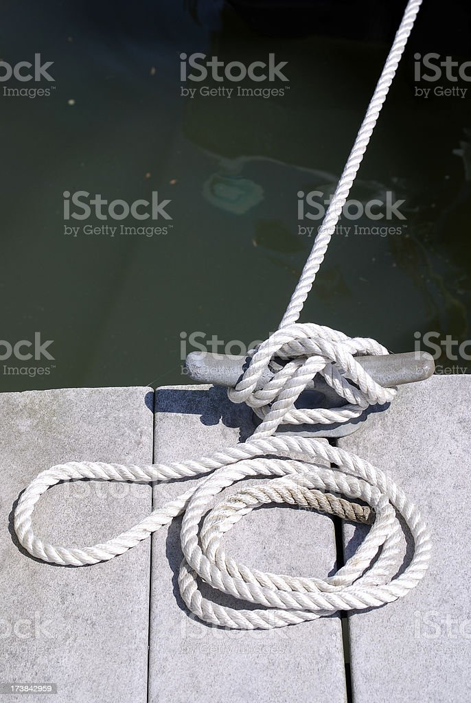 Boat rope tied up on a recycled dock royalty-free stock photo