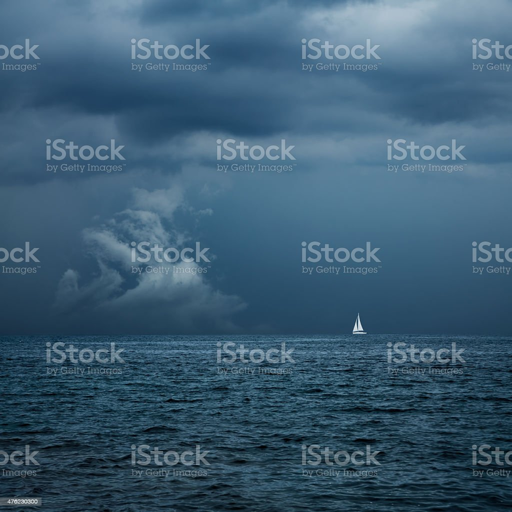 Boat Sailing in Center of Storm Formation stock photo