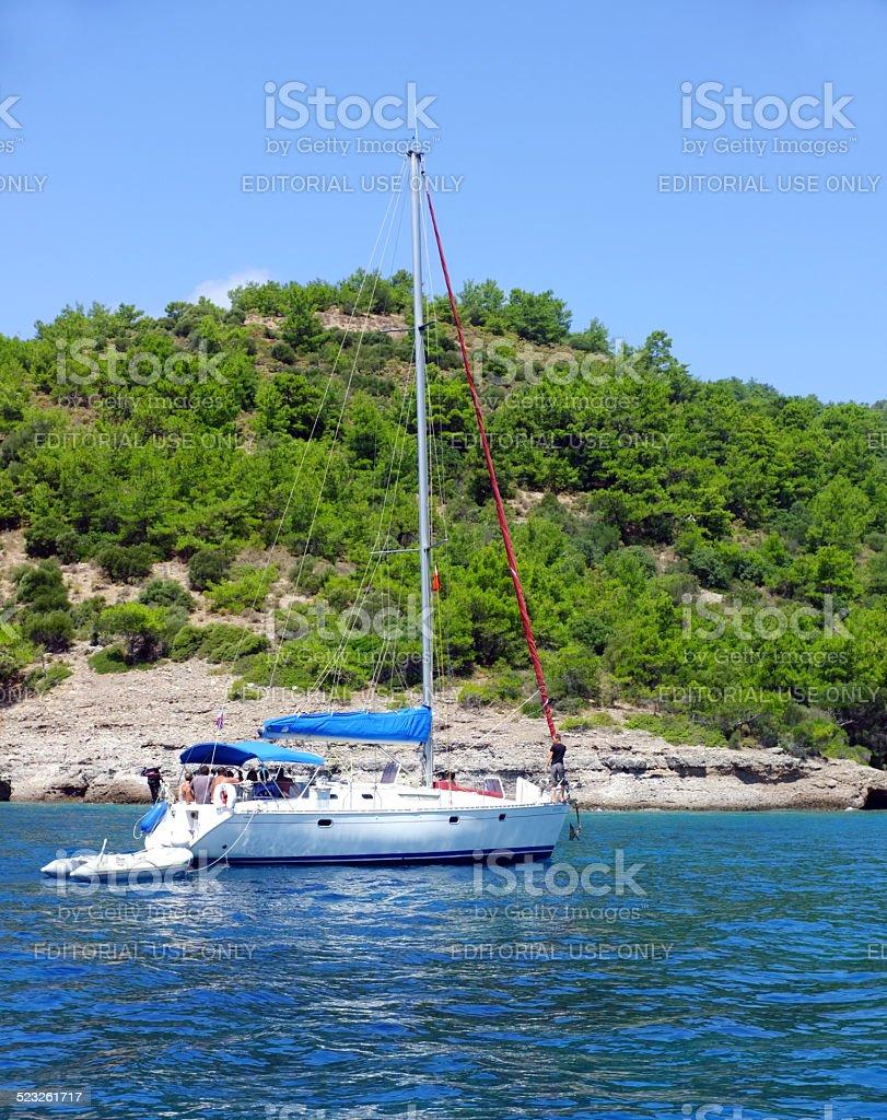 Boat sailing near shore stock photo