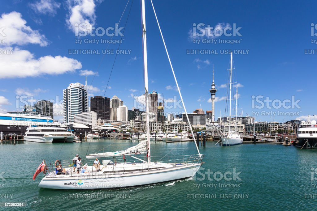 Boat sails back to the Viaduct harbour in Auckland stock photo