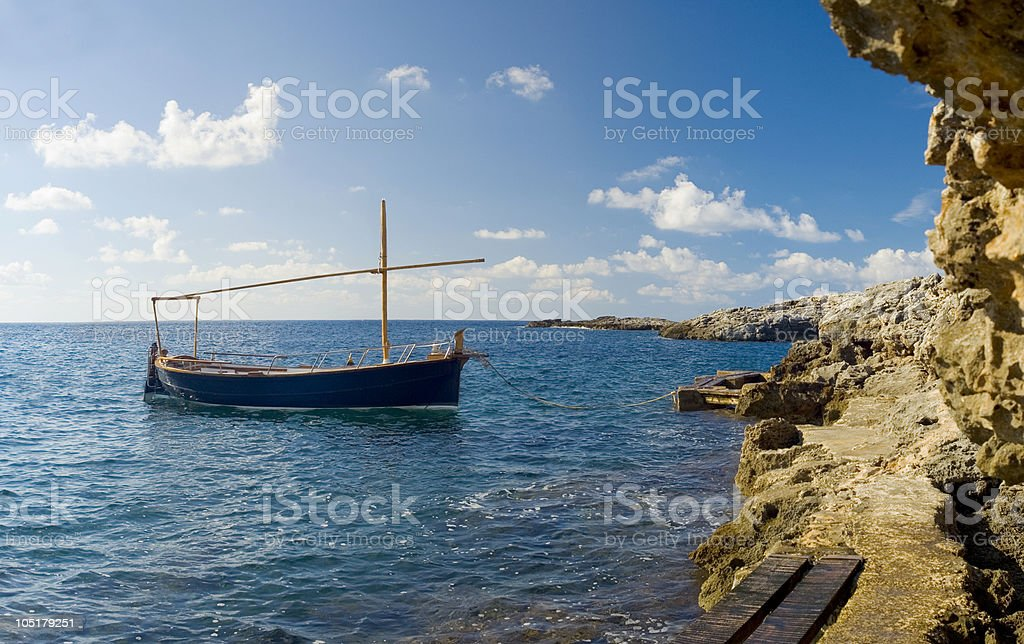 A boat that is drifting away on the sea stock photo