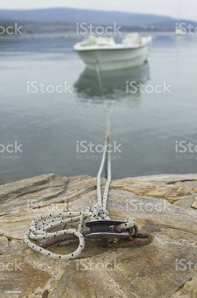 boat tied to dock royalty-free stock photo