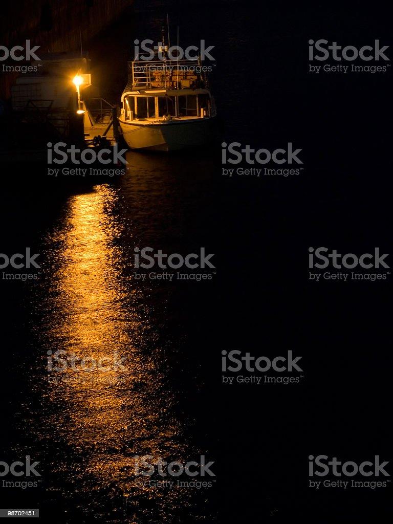 Boat tied up at night royalty-free stock photo