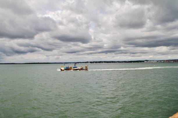 Boat towards Brownsea stock photo