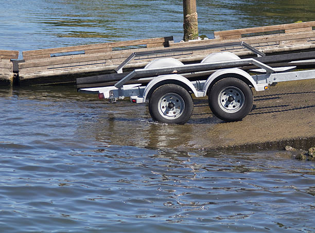 Boat Trailer Entering Water stock photo