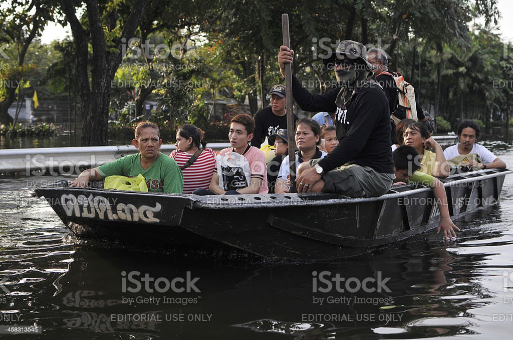 Boat Transports Flood Victims royalty-free stock photo