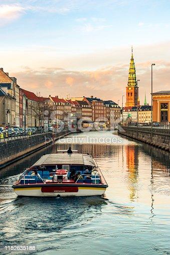 Boat trip in the canal overlooking the Sint Nicolaaskerk Church in Copenhagen, Denmark