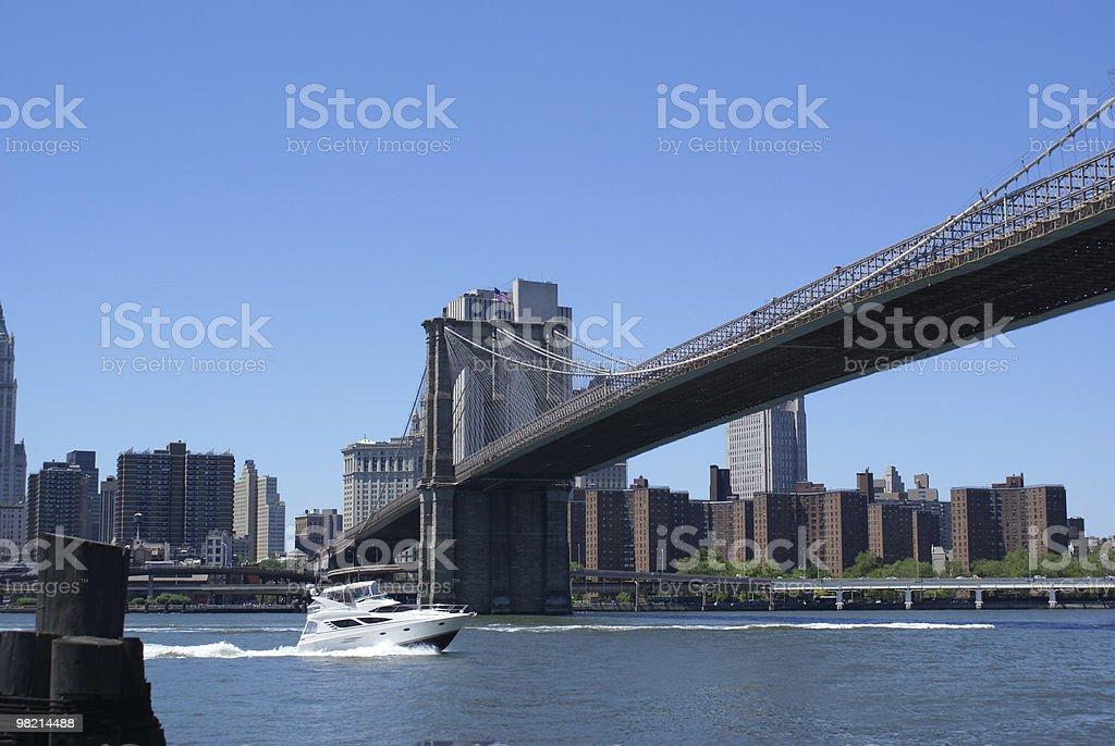 Boat Under Brooklyn Bridge royalty-free stock photo