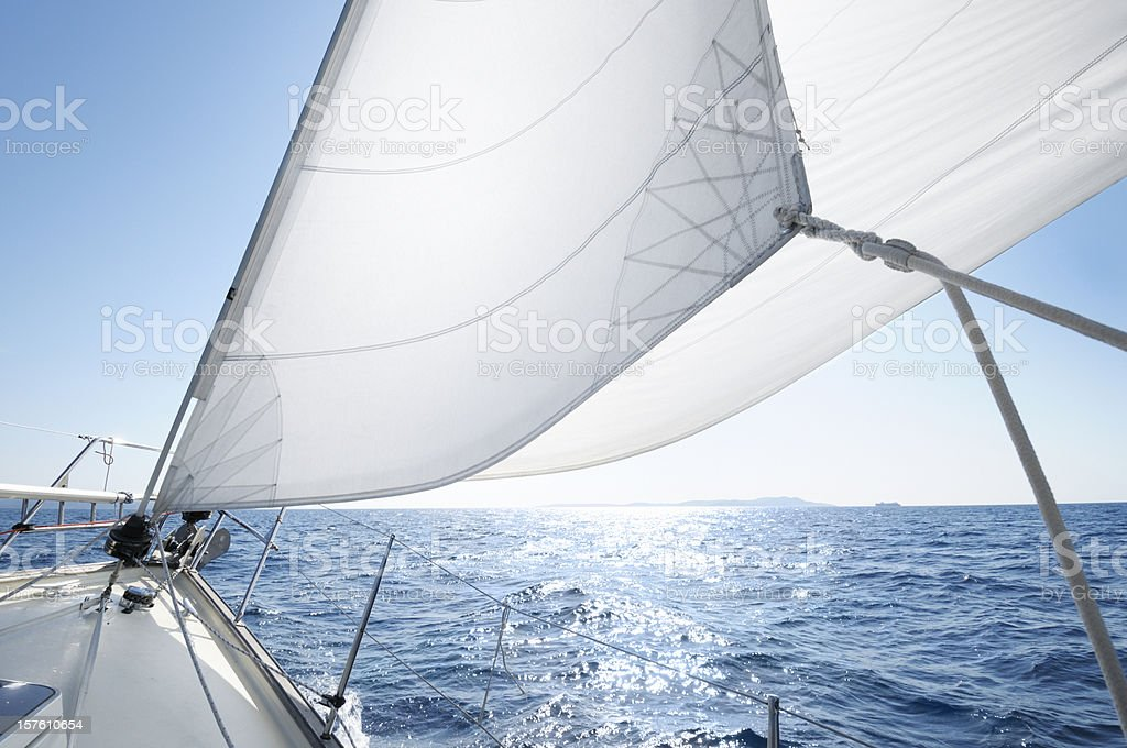 Boat under sail on a sunny day stock photo