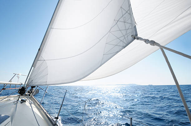 boat under sail on a sunny day - sail stock pictures, royalty-free photos & images