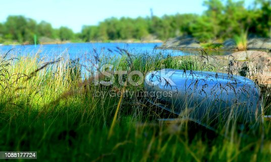 istock Boat upside down in the grass 1088177724
