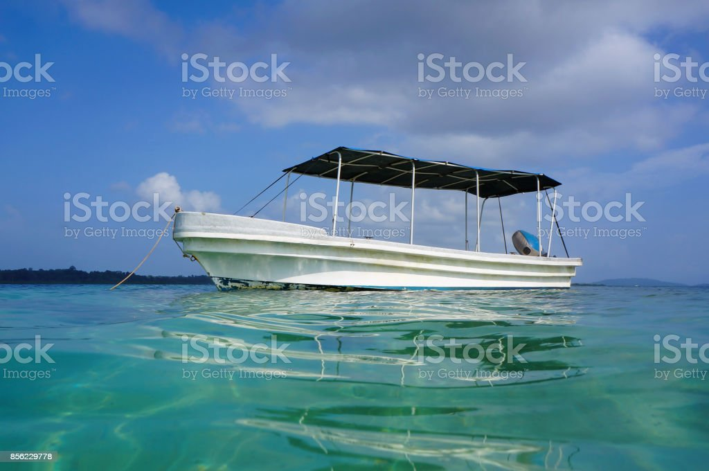 Boat viewed from water surface in Caribbean sea stock photo
