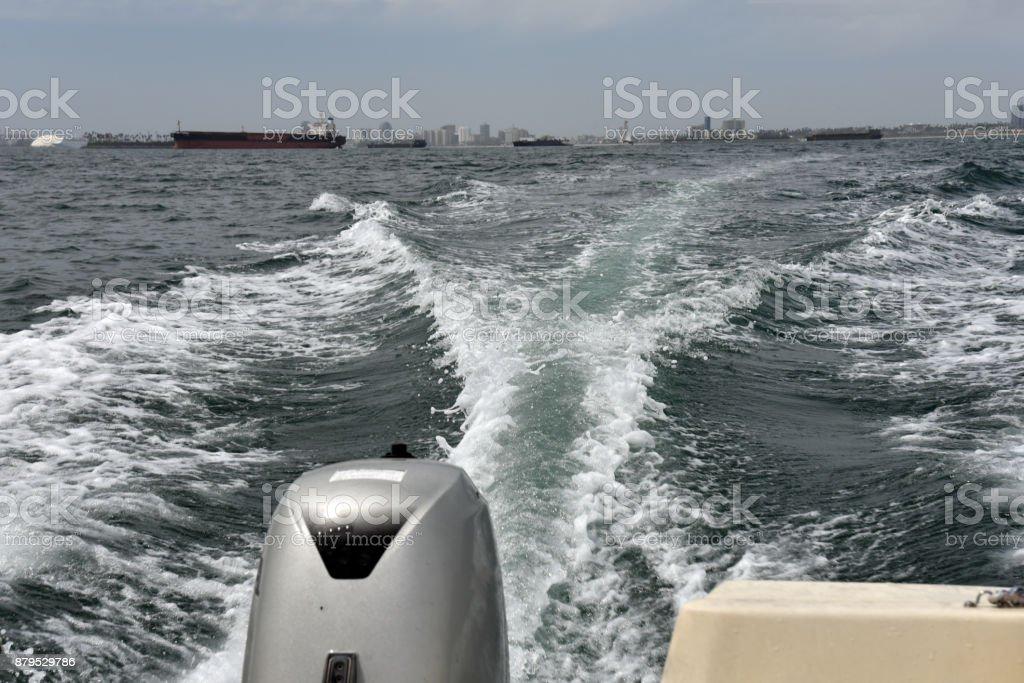 Boat wake in Long Beach Harbor stock photo