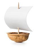 Sailboat made of walnut on white background.