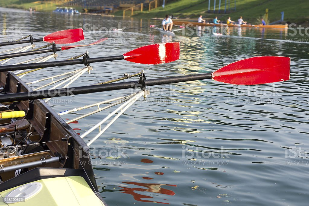 Boat with a red paddle stock photo
