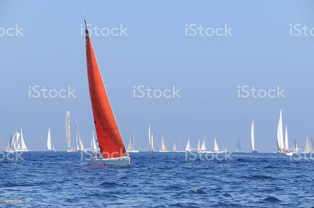 Boat with a red sail during the sailin competition stock photo